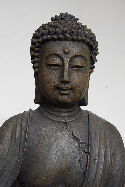 A Statue of the Buddha. Photograph by Alice Popkorn via Flickr