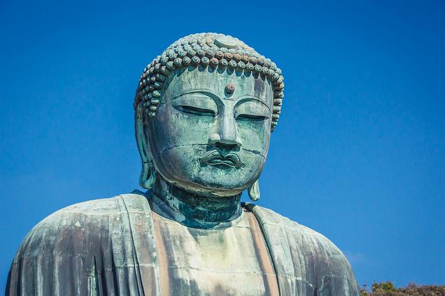 The famous Kamakura Buddha of Japan. Photograph by John Gillespie via Flickr